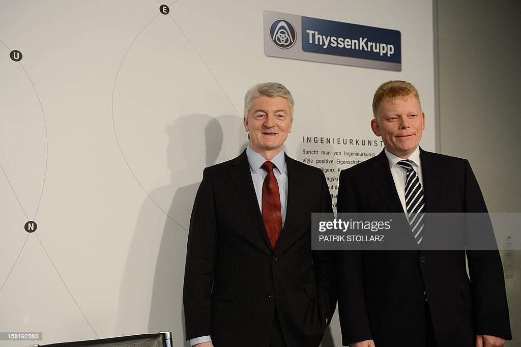 Heinrich Hiesinger (L), chairman of the German steelmaker ThyssenKrupp AG and Guido Kerkhoff, chief financial officer (CFO) pose for a picture prior to the annual press conference on December 11, 2012 in Essen, western Germany. German heavy industry giant ThyssenKrupp said it would not pay any annual dividends after it posted a loss of 4.7 billion euros for the year following a writedown of two loss-making steel plants.