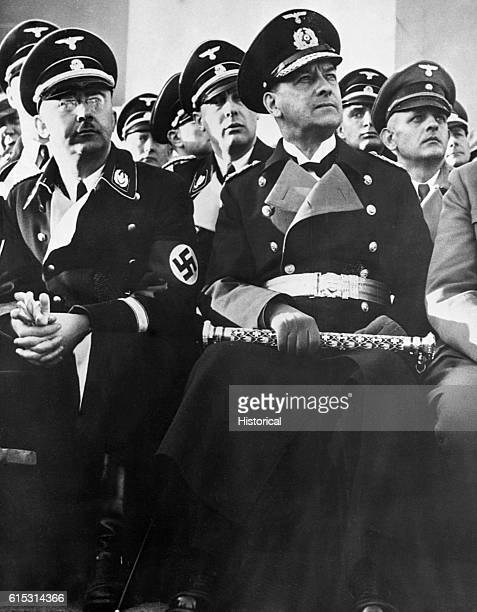Heinrich Himmler head of the Nazi Gestapo and SS and Erich Raeder Grand Admiral of Hitler's naval fleet attend a ceremony in full dress uniform