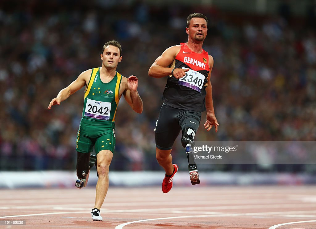 Heinrich Popow of Germany crosses the line to win gold ahead of silver medallist Scott Reardon of Australia in the Men's 100m T42 on day 9 of the London 2012 Paralympic Games at Olympic Stadium on September 7, 2012 in London, England.