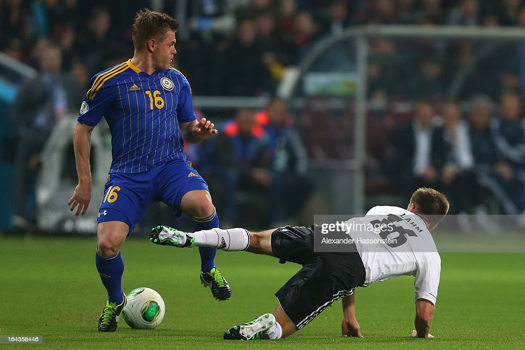 Heinrich Schmidtgal (L) of Kazakhstan battles for the ball with Philipp Lahm of Germany during the FIFA 2014 World Cup qualifier group C match between Kazakhstan and Germany at Astana Arena on March 22, 2013 in Astana, Kazakhstan.