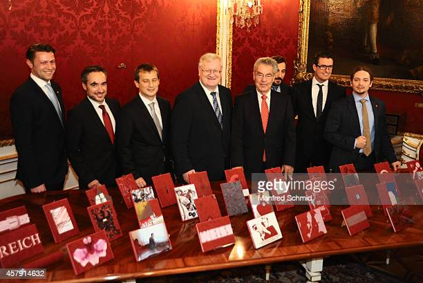 Heinz Fischer poses with some artists for a photograph during the press preview 'Hofburg Ein Stueck Geschichte' at Hofburg Vienna on October 24 2014...