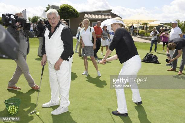 Heinz Hoenig and Suzanne von Borsody during the 10th GRK Golf Charity Masters on August 19 2017 in Leipzig Germany