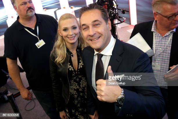 HeinzChristian Strache lead candidate of the rightwing Austria Freedom Party and his wife Philippa Strache arrive for television interviews following...