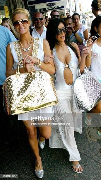 IMAGE Heiress Paris Hilton nearly causes a riot as she shops with friend Kim Kardashian in Paddington on December 31 2006 in Sydney Australia