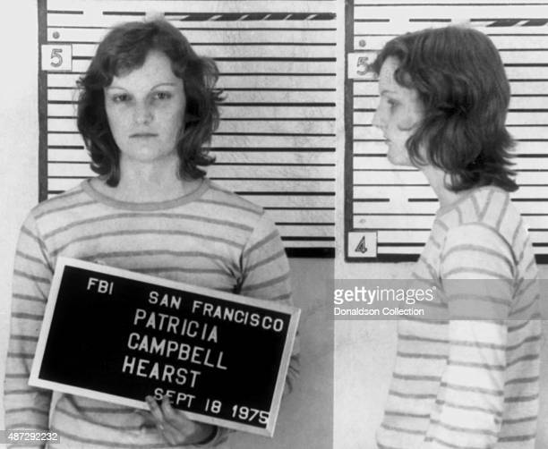 Heiress Patty Hearst poses for an FBI mugshot after her arrest for bank robbery on September 18 1975 in San Francisco California