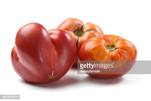 Heirloom fresh juicy tomatoes irregular in shape isolated : Stock Photo