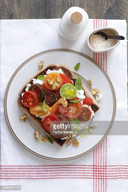 Heirloom tomato bruschetta with labneh and walnuts