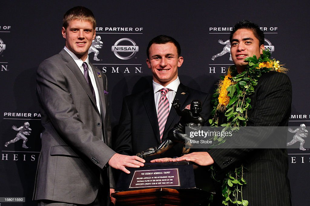 Heisman finalists quarterback <a gi-track='captionPersonalityLinkClicked' href=/galleries/search?phrase=Collin+Klein&family=editorial&specificpeople=5838707 ng-click='$event.stopPropagation()'>Collin Klein</a> of the Kansas State Wildcats, quarterback <a gi-track='captionPersonalityLinkClicked' href=/galleries/search?phrase=Johnny+Manziel&family=editorial&specificpeople=9703372 ng-click='$event.stopPropagation()'>Johnny Manziel</a> of the Texas A&M University Aggies and linebacker <a gi-track='captionPersonalityLinkClicked' href=/galleries/search?phrase=Manti+Te%27o&family=editorial&specificpeople=5654571 ng-click='$event.stopPropagation()'>Manti Te'o</a> of the University of Notre Dame Fighting Irish pose with the Heisman Memorial Trophy Award after a press conference prior to the 78th Heisman Trophy Presentation at the Marriott Marquis on December 8, 2012 in New York City.