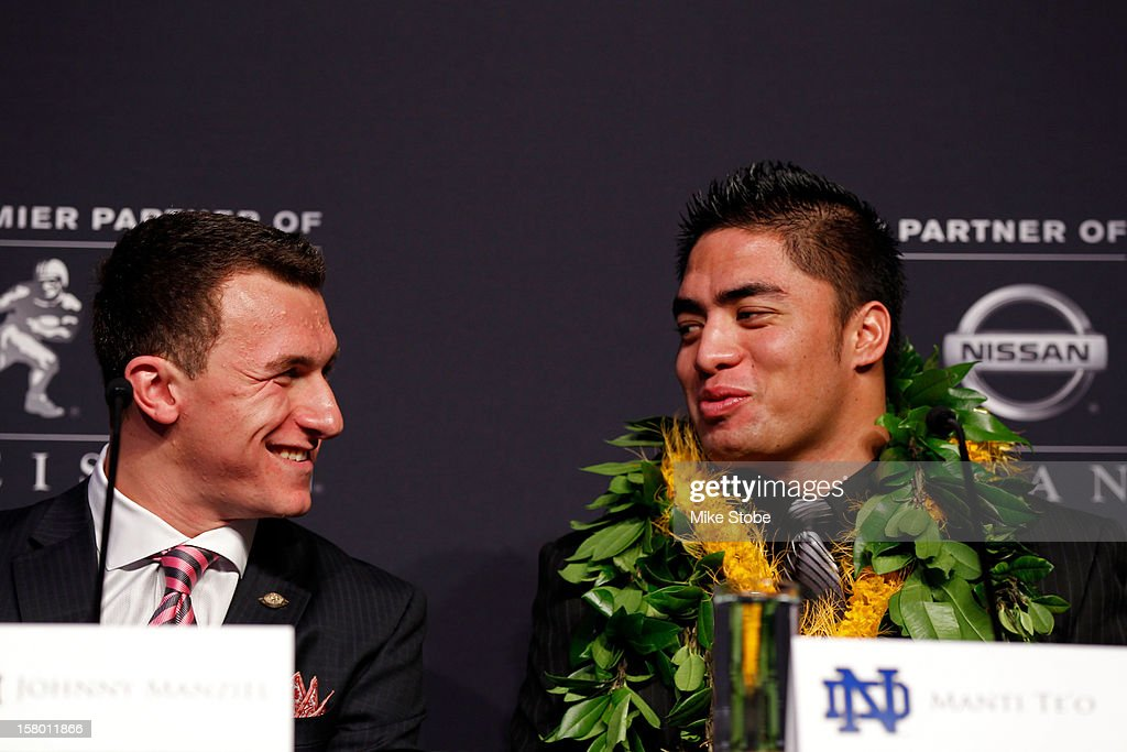 Heisman finalists quarterback Johnny Manziel of the Texas A&M University Aggies talks to linebacker Manti Te'o of the University of Notre Dame Fighting Irish during a press conference prior to the 78th Heisman Trophy Presentation at the Marriott Marquis on December 8, 2012 in New York City.