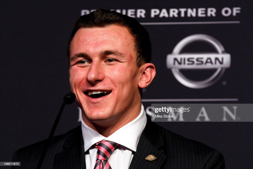 Heisman finalists quarterback Johnny Manziel of the Texas A&M University Aggies speaks during a press conference prior to the 78th Heisman Trophy Presentation at the Marriott Marquis on December 8, 2012 in New York City.