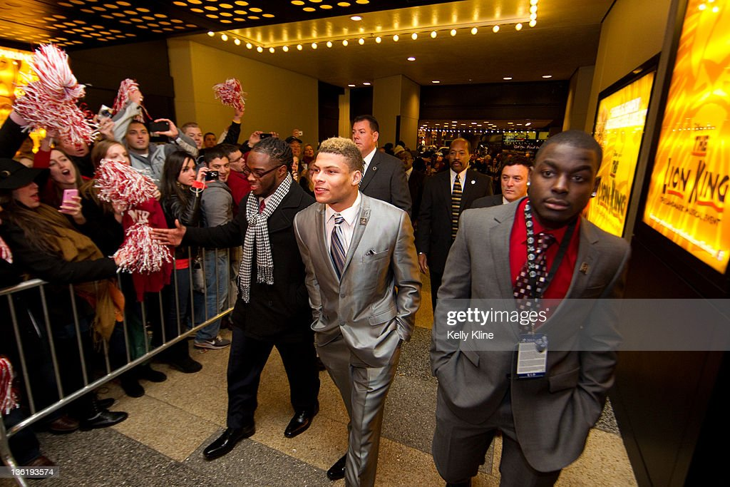 Heisman Trophy finalists, running back Trent Richardson of the Alabama Crimson Tide, cornerback Tyrann Mathieu of the LSU Tigers and running back Montee Ball of the Wisconsin Badgers arrive at the Best Buy Theater prior to the 77th Heisman trophy presentation on December 10, 2011 in New York City.