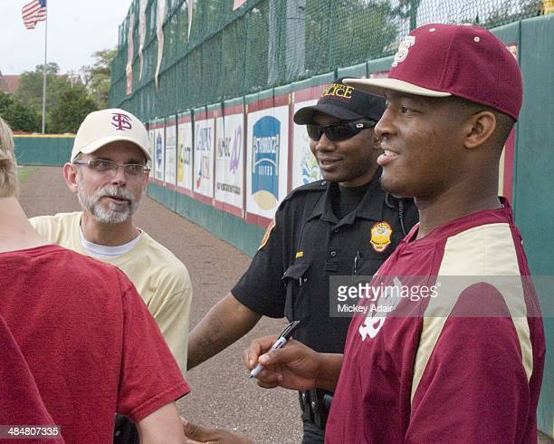 Heisman Trophy winner Jameis Winston signs autographs prior to baseball game between Florida State and Notre Dame Winston plays outfield switch hits...