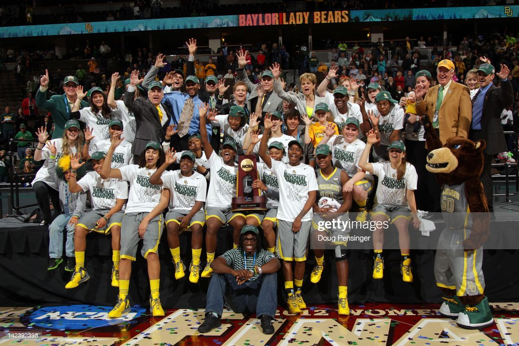 Heisman trophy winning quarterback Robert Griffin III from the Baylor Bears poses for a photo with the Baylor Bears including Brittney Griner and...
