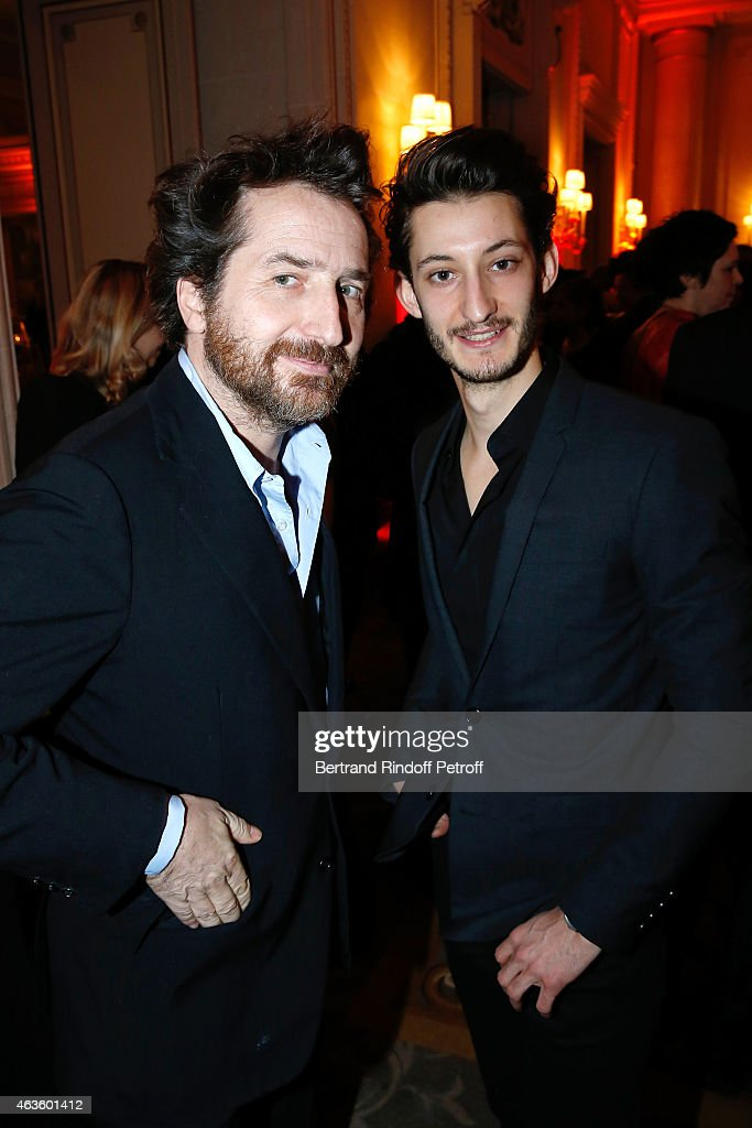 Actors <a gi-track='captionPersonalityLinkClicked' href=/galleries/search?phrase=Edouard+Baer&family=editorial&specificpeople=2455096 ng-click='$event.stopPropagation()'>Edouard Baer</a> and <a gi-track='captionPersonalityLinkClicked' href=/galleries/search?phrase=Pierre+Niney&family=editorial&specificpeople=8306328 ng-click='$event.stopPropagation()'>Pierre Niney</a> attend the 'Diner Des Producteurs' - Producer's Dinner - Cesar 2015. Held at Hotel George V on February 16, 2015 in Paris, France.
