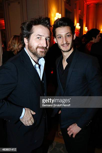 Actors Edouard Baer and Pierre Niney attend the 'Diner Des Producteurs' Producer's Dinner Cesar 2015 Held at Hotel George V on February 16 2015 in...