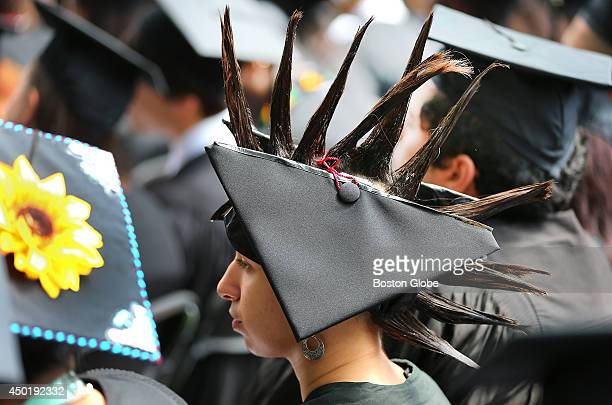 MIT held its graduation on its campus Alicia has her spiked hair protrude through her split cap She majored in Women and Gender Studies