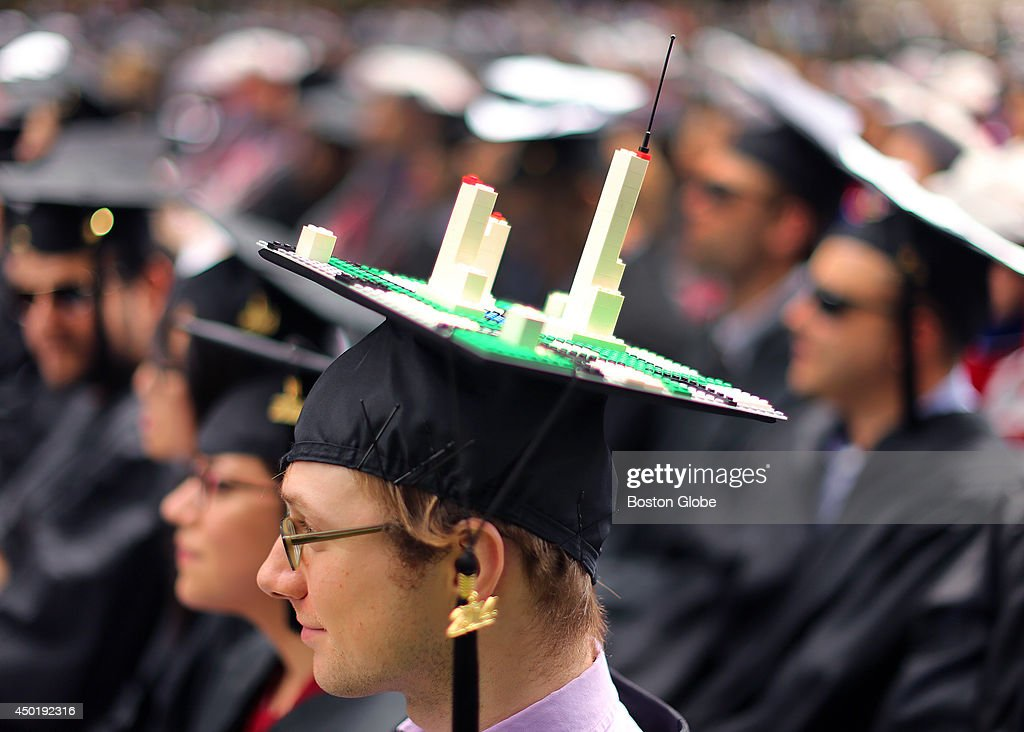 MIT held its graduation on its campus . Ira Winder from Ashville, N.C. supports a lego skyscraper skyline on his cap. He received a Master in City Planning.