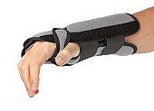 Human hand with a wrist brace, orthopeadic equipment over white