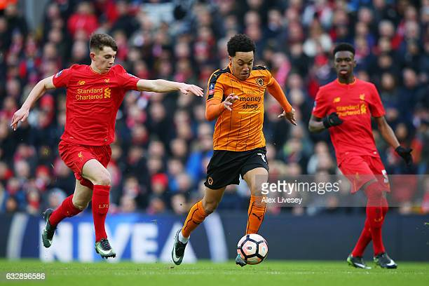 Helder Costa of Wolverhampton Wanderers and Ben Woodburn of Liverpool in action during the Emirates FA Cup Fourth Round match between Liverpool and...