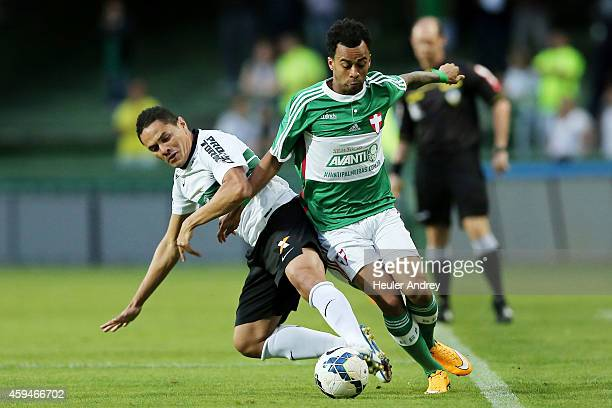 Helder of Coritiba competes for the ball with Wesley of Palmeiras during the match between Coritiba and Palmeiras for the Brazilian Series A 2014 at...