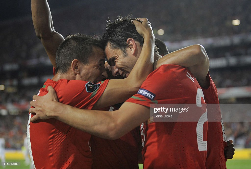 <a gi-track='captionPersonalityLinkClicked' href=/galleries/search?phrase=Helder+Postiga&family=editorial&specificpeople=227423 ng-click='$event.stopPropagation()'>Helder Postiga</a> (R) of Portugal celebrates with <a gi-track='captionPersonalityLinkClicked' href=/galleries/search?phrase=Carlos+Martins&family=editorial&specificpeople=685923 ng-click='$event.stopPropagation()'>Carlos Martins</a> after scoring Portugal's opening goal during the EURO 2012 Group H qualifier between Portugal and Norway at Estadio do Sport Lisboa e Benfica on June 4, 2011 in Lisbon, Portugal.