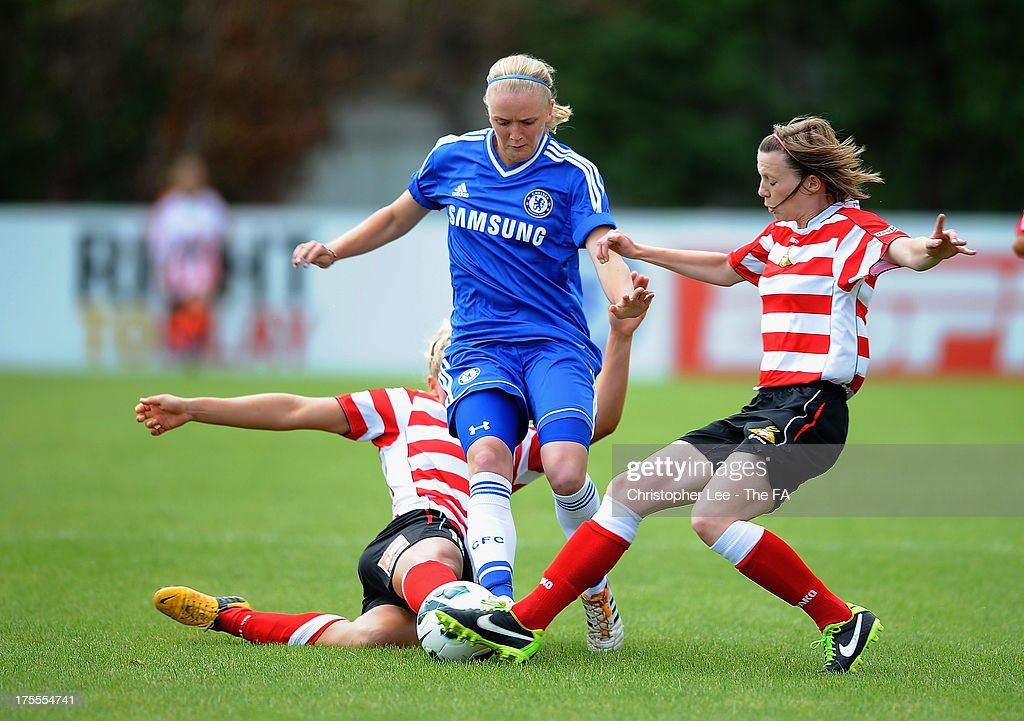 Helen Bleazard of Chelsea rides the tackles from Millie Bright and Lindsay Cunningham of Doncaster during The FA Womens Super League match between Chelsea Ladies and Doncaster Rovers Belles Ladies at Wheatsheaf Park on August 4, 2013 in Staines, England.