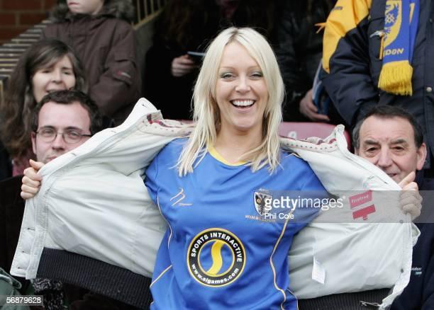 Helen Chamberlain shows off her Shirt before the Ryman League Premier Division match between AFC Wimbledon and Windsor Eton FC at Kingmeadow Stadium...