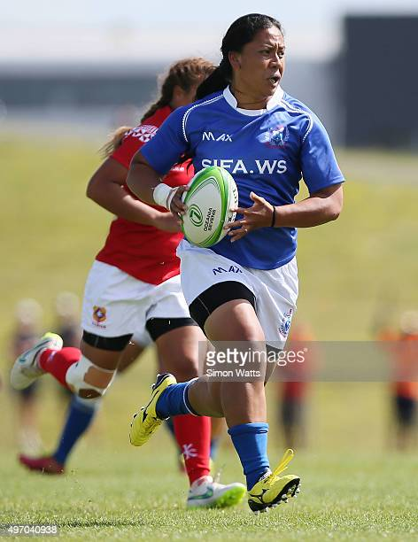 Helen Collins of Samoa runs away for a try during the World Sevens Oceania Olympic Qualification match between Samoa and Tonga on November 14 2015 in...