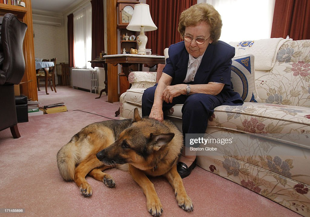 Helen Fahey pets her guide dog Fletch as she poses for a portrait at her home in Arlington, Mass., June 6, 2013.