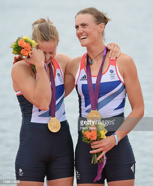 Helen Glover and Heather Stanning of Great Britain celebrate with their gold medals during the medal ceremony after the Women's Pair Final A on Day 5...