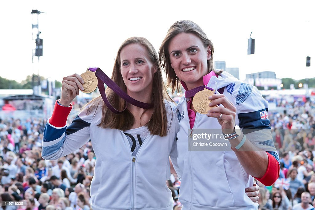 Helen Glover and Heather Stanning who won gold in the women's pairs rowing competition at the London 2012 Olympics pose on stage with their gold medals during BT London Live at Hyde Park on August 2, 2012 in London, United Kingdom.
