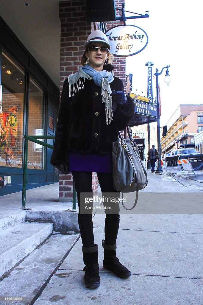 Helen Gordon, Human Resources Administrator from Atlanta, wearing Diesel hat, hat, J. Mendel fur coat, Ralph Lauren sweater, Ralph Lauren pants, Ferragamo boots, Prada bag, and Gucci sunglasses on January 17, 2013 on the streets of Park City, Utah.