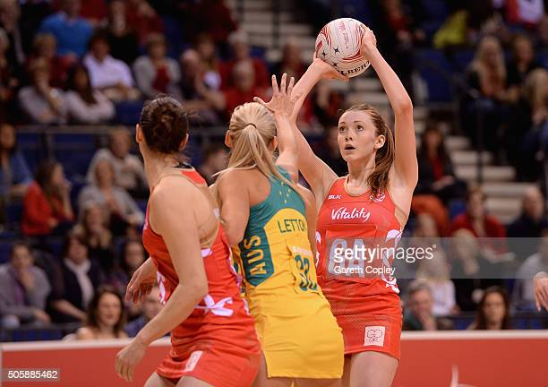 Helen Housby of England shoots during the first match of the Vitality Netball International Series between England and Australia at the Echo Arena on...