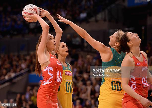 Helen Housby of England shoots past Clare Medhurst of Australia during the first match of the Vitality Netball International Series between England...