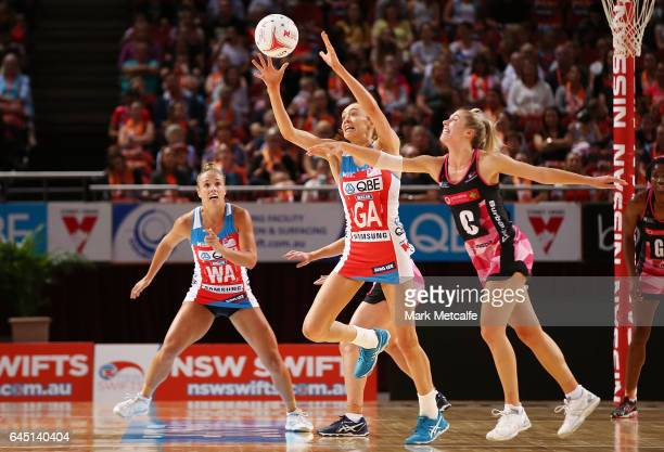 Helen Housby of the Swifts and Gia Abernethy of the Thunderbirds contest possession during the round two Super Netball match between the Sydney...