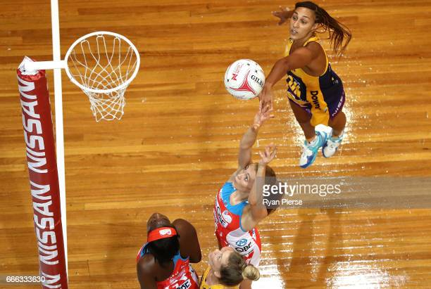 Helen Housby of the Swifts shoots at goal despite pressure from Geva Mentor of the Lightning during the round eight Super Netball match between the...