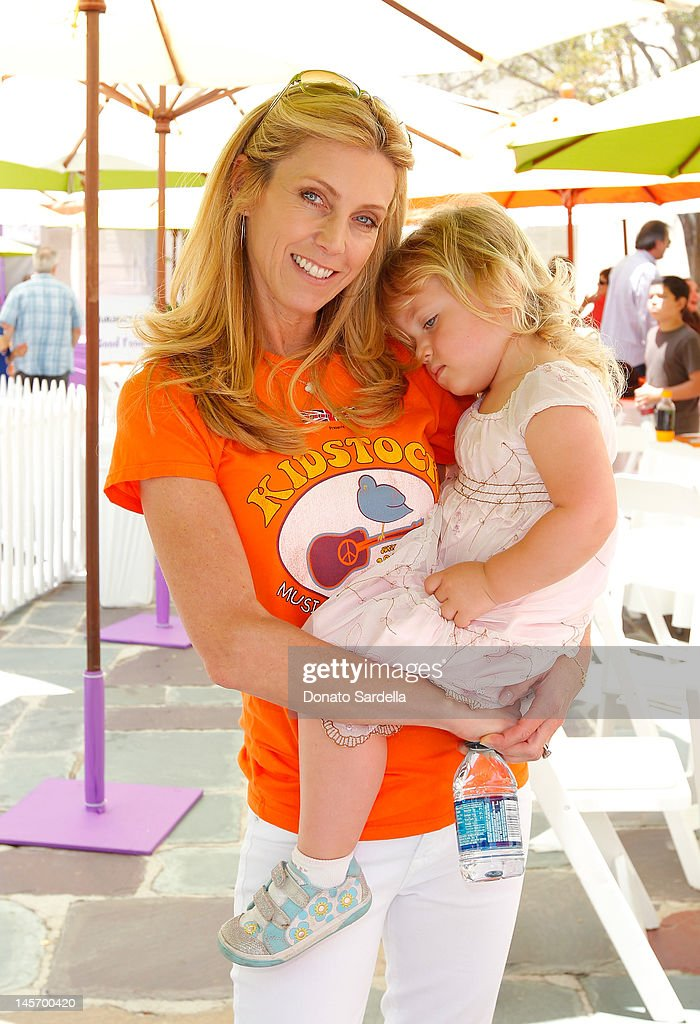 Helen Kinnear and daughter attends 6th Annual Kidstock Music And Arts Festival Sponsored By Hudson Jeans at Greystone Mansion on June 3, 2012 in Beverly Hills, California.