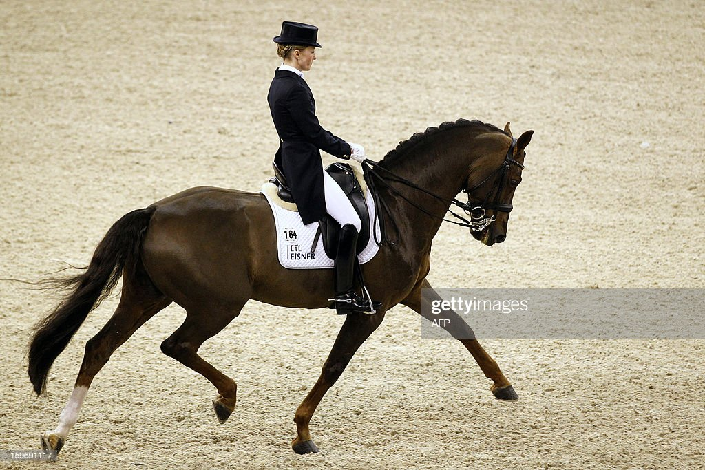 Helen Langehanenberg from Germany with Damon Hill compete during the World Cup dressage at the Jumping Amsterdam, on January 18, 2013 in Amsterdam. AFP PHOTO/ANP/ BAS CZERWINSKI netherlands out