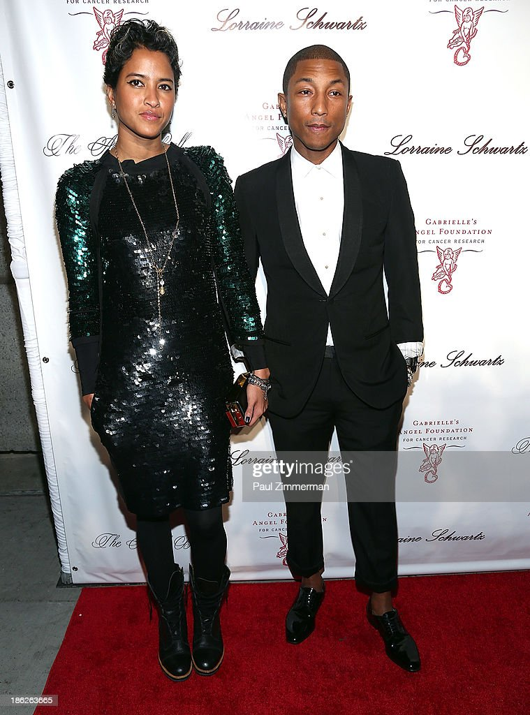 Helen Lasichanh (L) and Pharrel Williams attend Angel Ball 2013 at Cipriani Wall Street on October 29, 2013 in New York City.