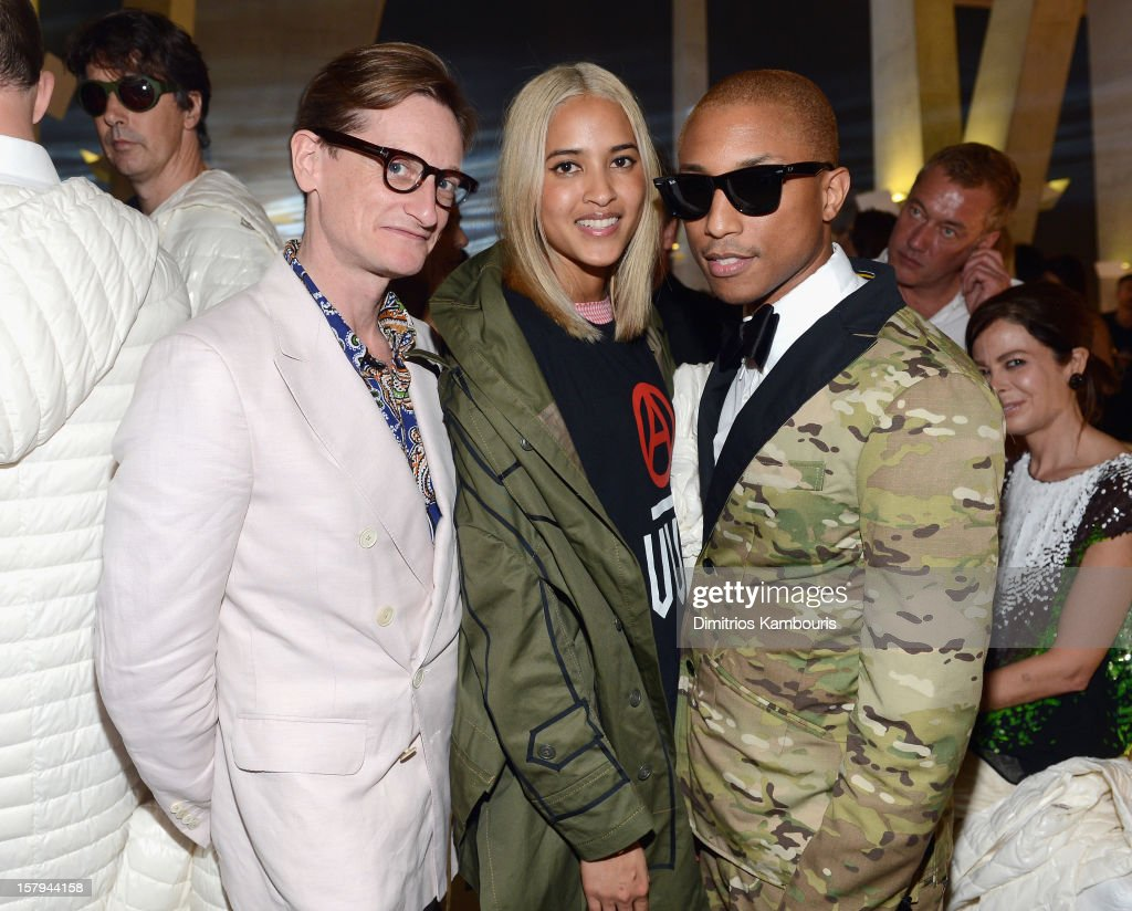 Helen Lasichanh and <a gi-track='captionPersonalityLinkClicked' href=/galleries/search?phrase=Pharrell+Williams&family=editorial&specificpeople=161396 ng-click='$event.stopPropagation()'>Pharrell Williams</a> attend a party as Moncler Celebrates Its 60th Anniversary At Art Basel Miami Beach on December 7, 2012 in Miami Beach, Florida.
