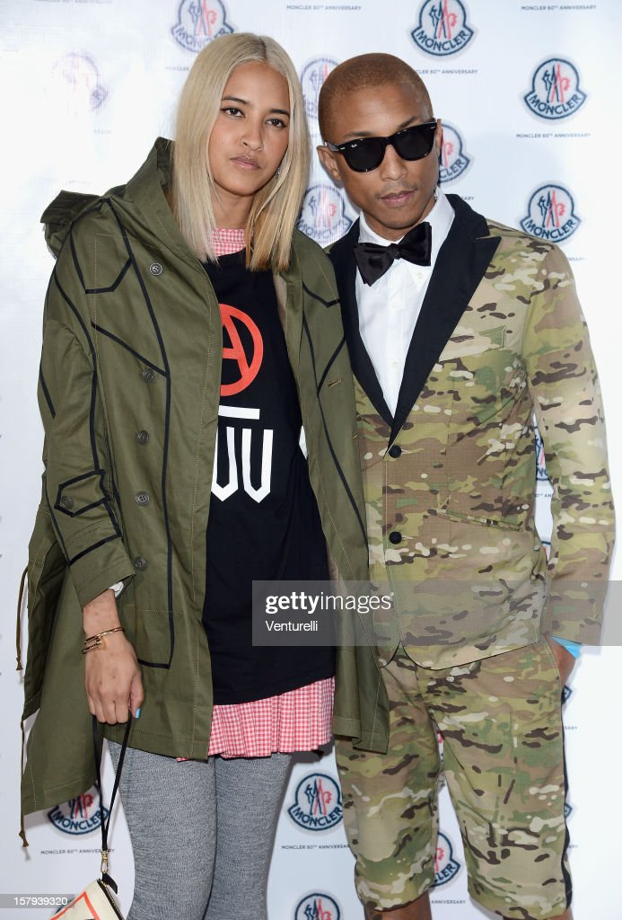 Helen Lasichanh and Pharrell Williams attend a private dinner celebrating Remo Ruffini and Moncler's 60th Anniversary during Art Basel Miami Beach on December 7, 2012 in Miami Beach, Florida.