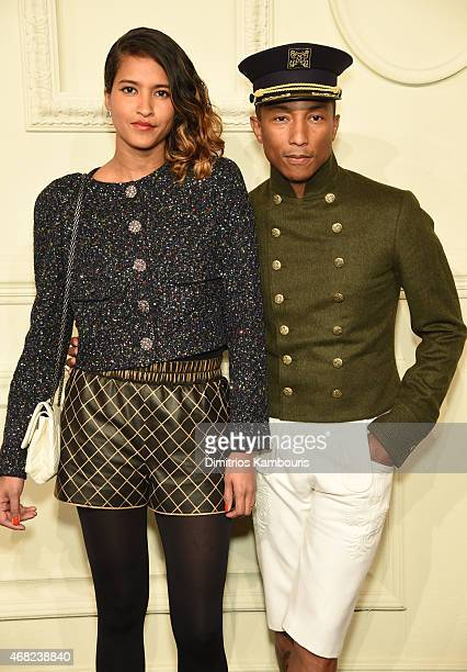 Helen Lasichanh and Pharrell Williams attend the CHANEL ParisSalzburg 2014/15 Metiers d'Art Collection at Park Avenue Armory on March 31 2015 in New...
