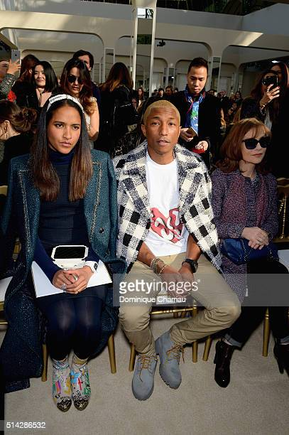 Helen Lasichanh and Pharrell Williams attend the Chanel show as part of the Paris Fashion Week Womenswear Fall/Winter 2016/2017 on March 8 2016 in...
