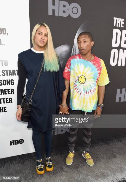 Helen Lasichanh and Pharrell Williams attend the premiere Of HBO's 'The Defiant Ones' at Paramount Theatre on June 22 2017 in Hollywood California
