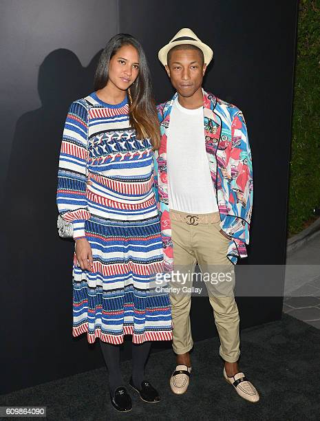 Helen Lasichanh and Pharrell Williams both wearing Chanel attend the Chanel dinner celebrating N°5 L'Eau with LilyRose Depp at Sunset Tower Hotel on...