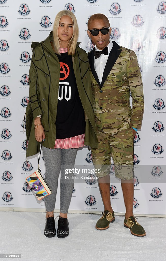 Helen Lasichanh and producer Pharrell Williams attend a private dinner celebrating Remo Ruffini and Moncler's 60th Anniversary during Art Basel Miami Beach on December 7, 2012 in Miami Beach, Florida.