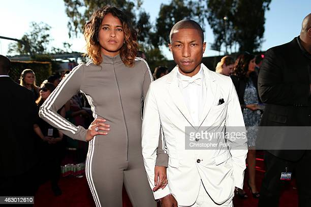 Helen Lasichanh and recording artist Pharrell Williams attend The 57th Annual GRAMMY Awards at the STAPLES Center on February 8 2015 in Los Angeles...