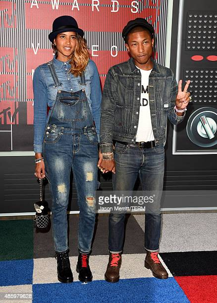 Helen Lasichanh and recording artist Pharrell Williams attend the 2015 MTV Video Music Awards at Microsoft Theater on August 30 2015 in Los Angeles...