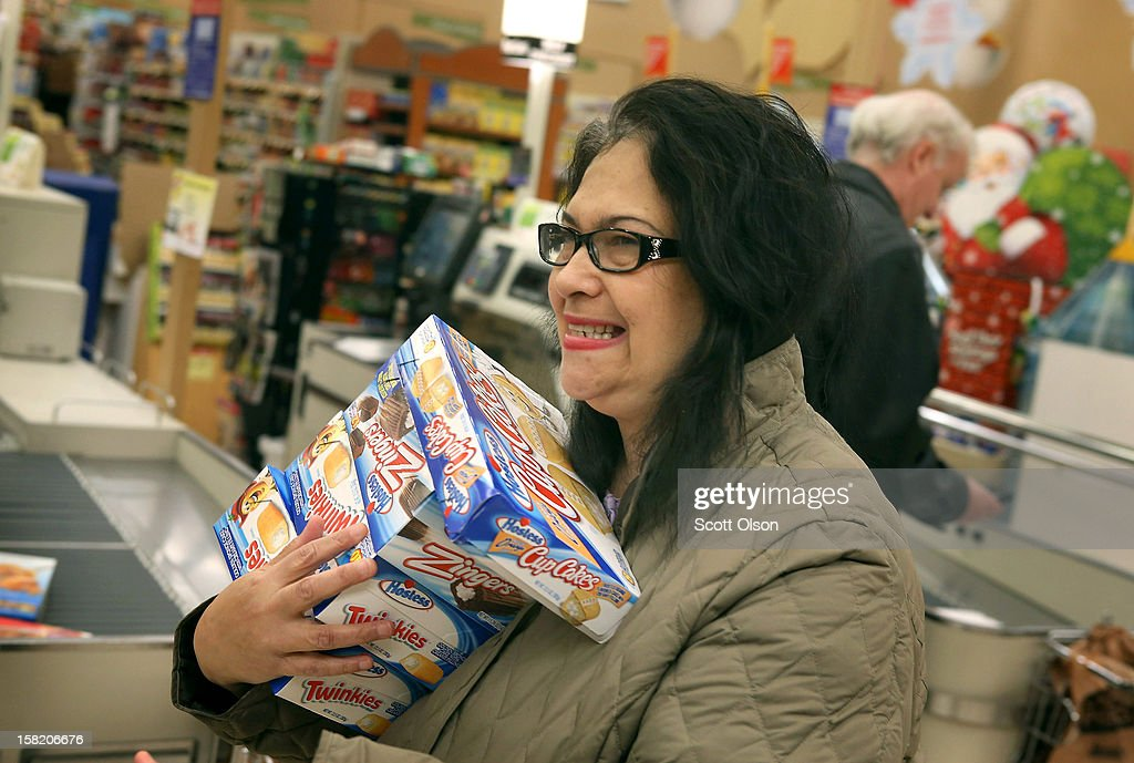 Helen Lumpp heads to the checkout with an armload of Hostess snacks at a Jewel-Osco grocery store on December 11, 2012 in Chicago, Illinois. The Jewel-Osco grocery store chain purchased the last shipment of 20,000 boxes of Hostess products and put them on sale in their stores throughout the Chicago area today. Hostess Brands Inc. shut down its baking operations and began liquidating assets last month after failing to negotiate a labor contract with Workers with the Bakery, Confectionery, Tobacco Workers and Grain Millers International Union