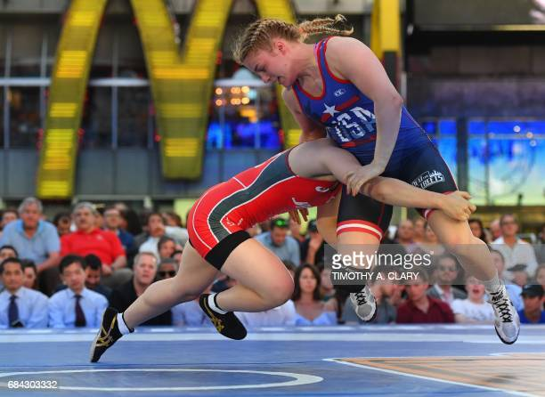 TOPSHOT Helen Maroulis of the United States and Yuzuru Kumano from Japan compete in the Womens freestyle 58 kg/128 lbs match during the Beat The...